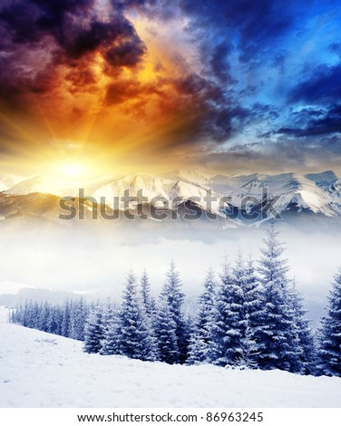 Majestic sunset in the winter mountains landscape. Dramatic sky. - stock photo