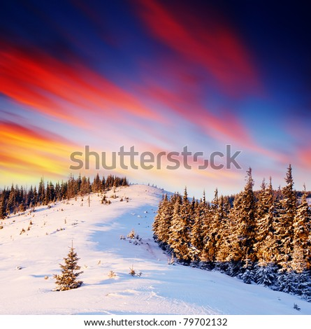 Majestic sunset in the winter mountains landscape. Frosty day - stock photo