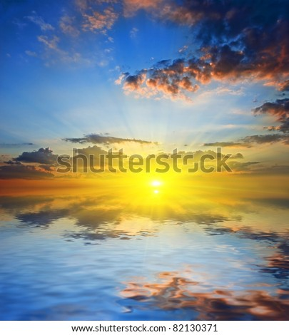 majestic sunset on a quiet sea - stock photo