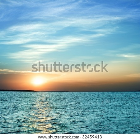 majestic sunset on a river - stock photo