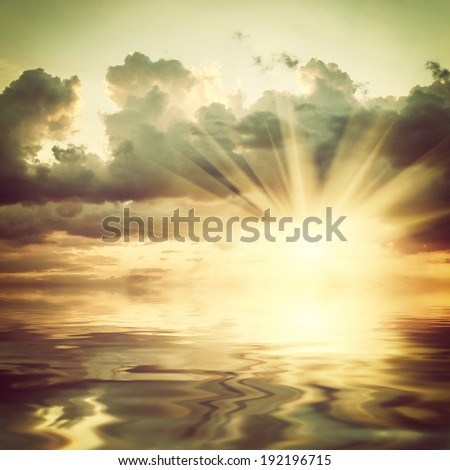 Majestic sunset over sea, cloud reflection in water