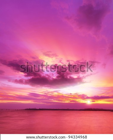 Majestic sunset over the sea. Vertical composition. - stock photo