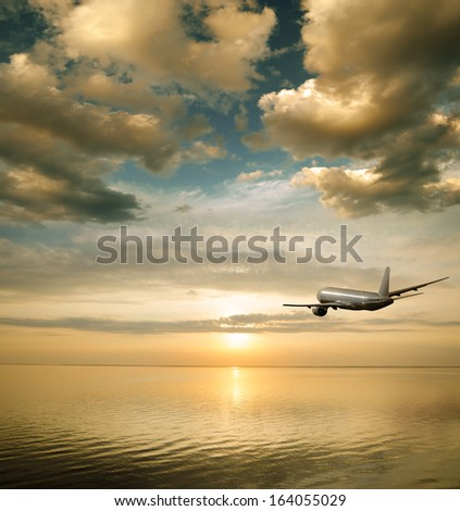 majestic sunset over the water surface - stock photo
