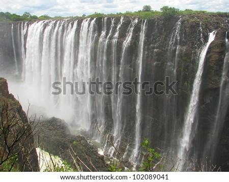 Majestic Victoria Falls on Zambezi River, border of Zambia and Zimbabwe - stock photo