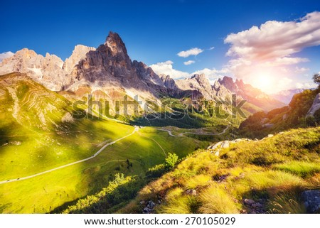 Majestic view of the Cimon della Pala with passo Rolle. National Park Paneveggio. Dolomites, South Tyrol. Location Pale di San Martino. Italy, Europe. Dramatic unusual scene. Beauty world. - stock photo