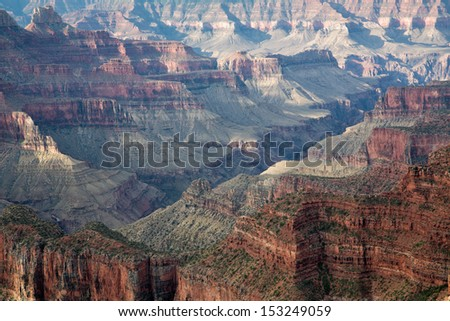 Majestic view of the Grand Canyon, North Rim, with the rocks lighted by the first sunrays at sunrise in National Park, Arizona, USA - stock photo