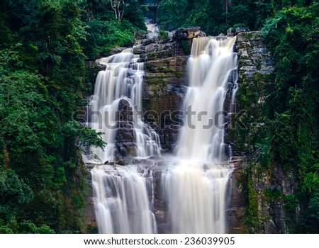 Majestic waterfall Ramboda symbol of Sri Lanka - stock photo