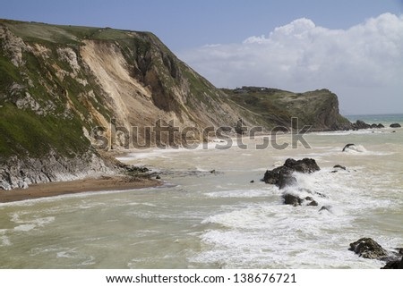 Major cliff collapse landslide on the Jurassic coast, St Oswald's Bay, Dorset, UK destroying the coastal path and discolouring the sea - stock photo