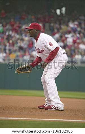 Major League baseball player for the Philadelphia Phillies, #6, slugger Ryan Howard, playing first base during March 31, 2008 opening game against Washington Nationals, at Citizens Bank Park - stock photo