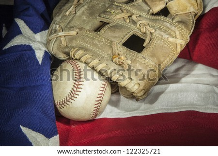 major league baseball with American flag and glove - stock photo