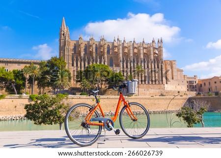 Majorca Palma Cathedral Seu and bicycle of Mallorca at Balearic Islands Spain - stock photo