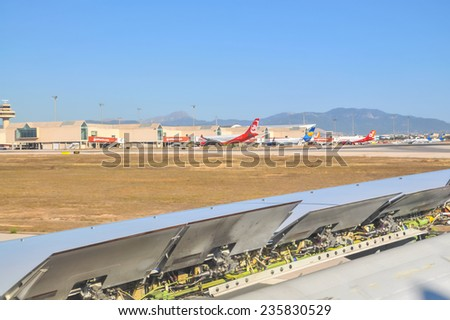MAJORCA, SPAIN - JULY 11 2014: Airline wing with landing break mechanics on July 11 2014 in Palma International airport Son Sant Joan, Palma de Mallorca, Balearic islands, Spain. - stock photo
