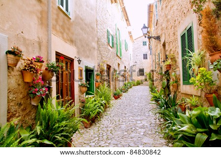 Majorca Valldemossa typical village with flower pots in facades at Spain - stock photo