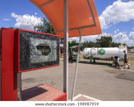 "MAKAROVO, LUHANSK REGIPN, UKRAINE - June 13, 2014: Damaged gas station ""Tyumen Oil Company"". In Makarovo village (about 20 km east of Lugansk) was shelled checkpoint pro-Russian insurgents."