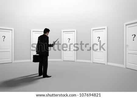 Make a decision. Choose a job. Be interviewed. Achieving the goal. Cease to be unemployed. Due to bureaucracy. With question marks on the doors. Recruitment. - stock photo