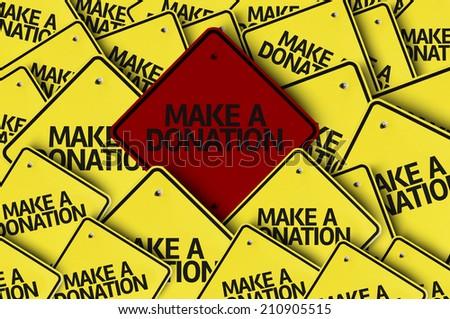Make a Donation written on multiple road sign  - stock photo