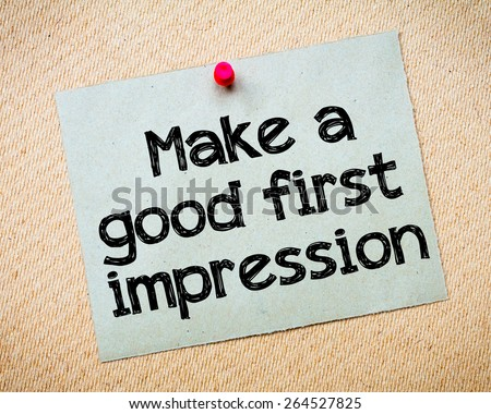 Make a first good impression Message. Recycled paper note pinned on cork board. Concept Image - stock photo