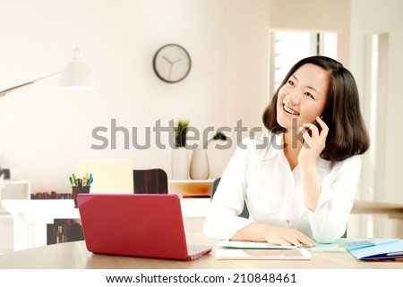 Make a phone call in the office - stock photo