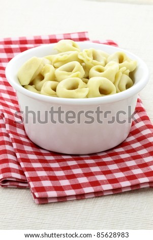 make an easy Italian-inspired recipe with the best stuffed tortellini with your choice of cheeses then top it with homemade tomato sauce. - stock photo