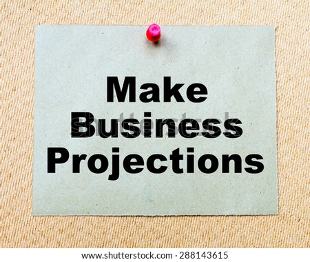 Make Business Projections written on paper note pinned with red thumbtack on wooden board. Business conceptual Image - stock photo