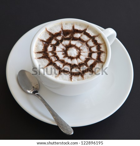 Make coffee latte with cream on black table - stock photo