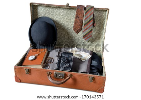 make his suitcase on a trip - stock photo