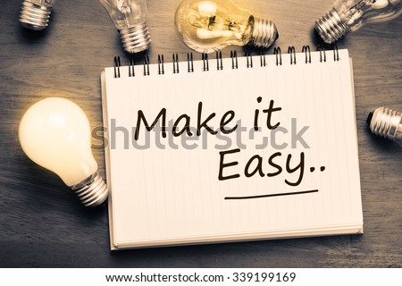 Make It Easy concept, handwriting on notebook with light bulbs - stock photo