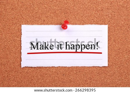 Make it happen text paper is pinned on cork. - stock photo