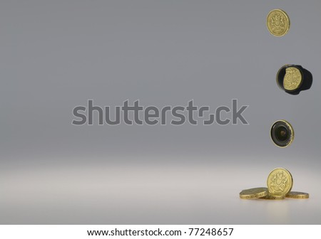 make money from photography concept, British One Pound Coins with a camera lens and lens hood. - stock photo