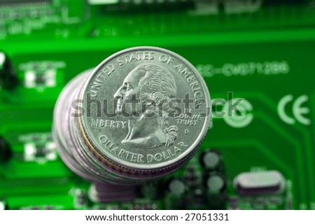 Make money on IT: quarter dollar coins over green microcircuit