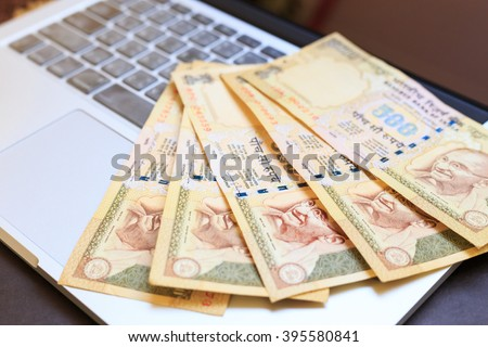 Make money with computer laptop, India currency, Rupee - stock photo