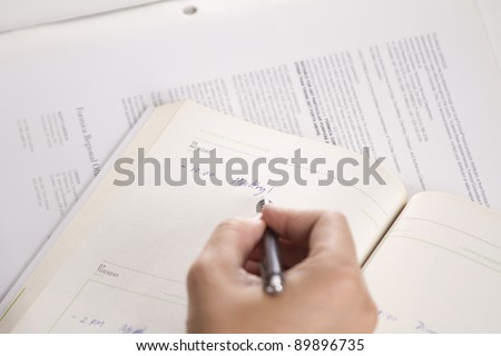 make schedule, male hand writing schedule meeting on agenda. - stock photo