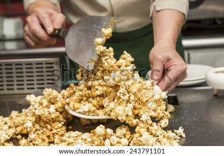 make sweet pop corn on teppanyaki - stock photo