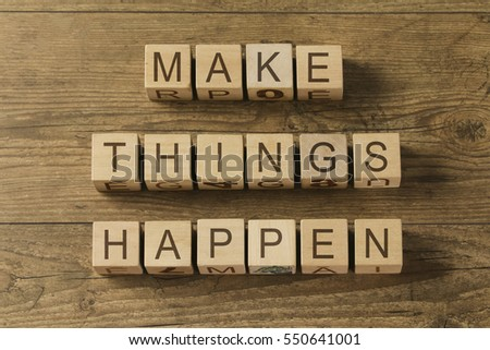 Make things happen motivational reminder on cubes on wooden background