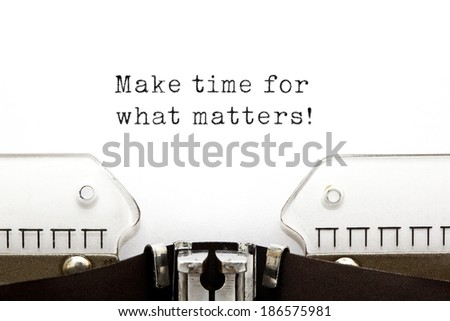 Make time for what matters! printed on an old typewriter.  - stock photo