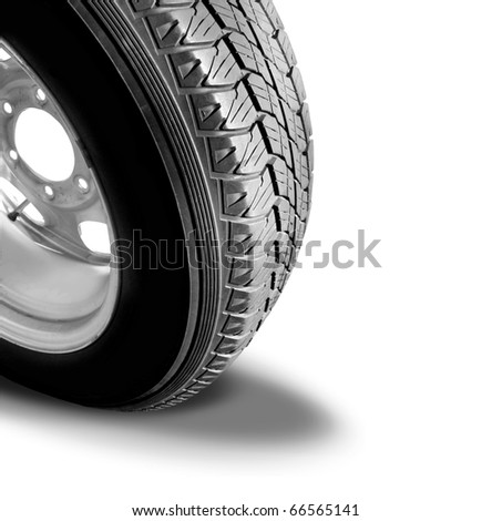 Make Tyre Tracks: Isolated Car Tyre With Drop Shadow - stock photo