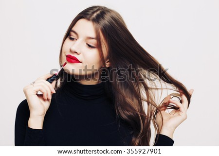 Make-up and cosmetics. Beautiful model girl makeup. Perfect skin. Professional make up. Red lips