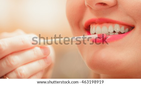 Make up artist applying lipstick with brush on woman lips. Closeup of visagiste and girl. Beauty and makeup concept.