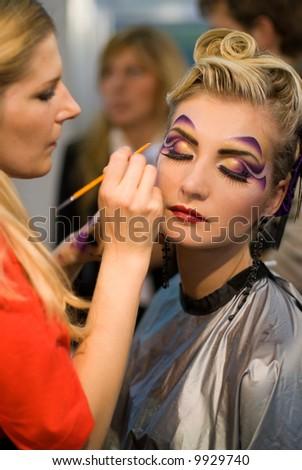 Make-up artist at work - stock photo