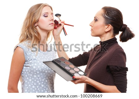 make up artist with beautiful model isolated on white - stock photo