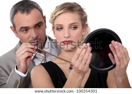 Make-up artist with model - stock photo