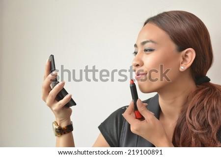 Make Up. asian woman wearing make up. - stock photo