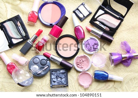 Make up assortment: lipsticks, nail polishes, blusher, eye shadows, foundation and powder of different colours - stock photo