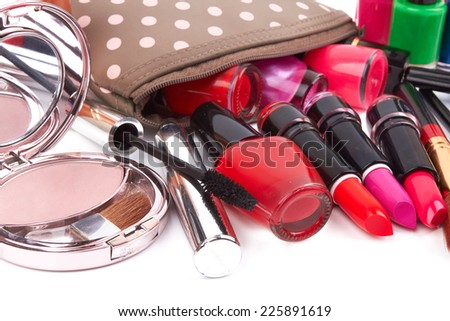 Make up bag with cosmetics and brushes isolated on white  - stock photo