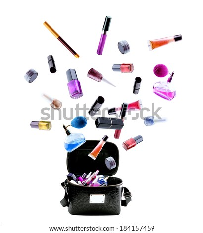 make up bag with flying out cosmetics, isolated on white - stock photo