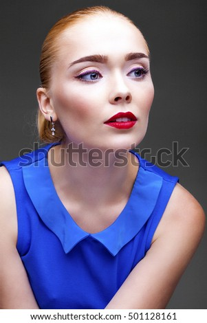 Make Up. Beautiful Blonde Girl. Isolated on dark gray background