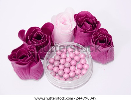make up blush for cheeks with roses around - stock photo