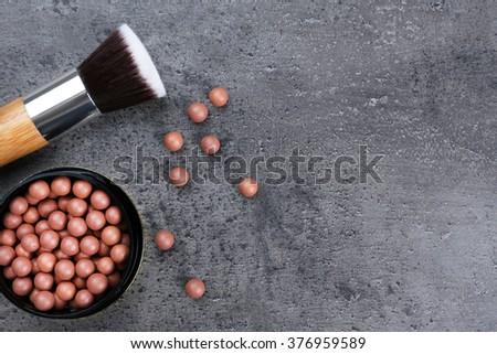 Make-up brush and blusher, on grey background - stock photo