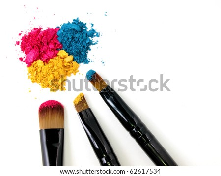 Make-up brush on colorful crushed eyeshadows - stock photo