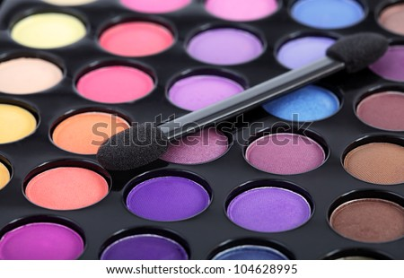 Make-up brush on colorful eye shadows palette